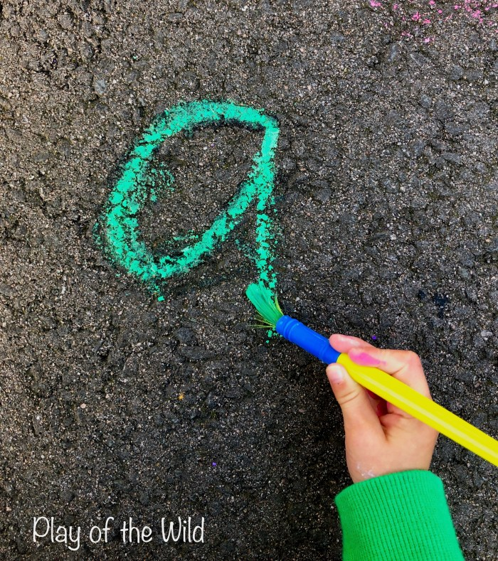 Letter formation for preschoolers. Practicing writing letters outside.