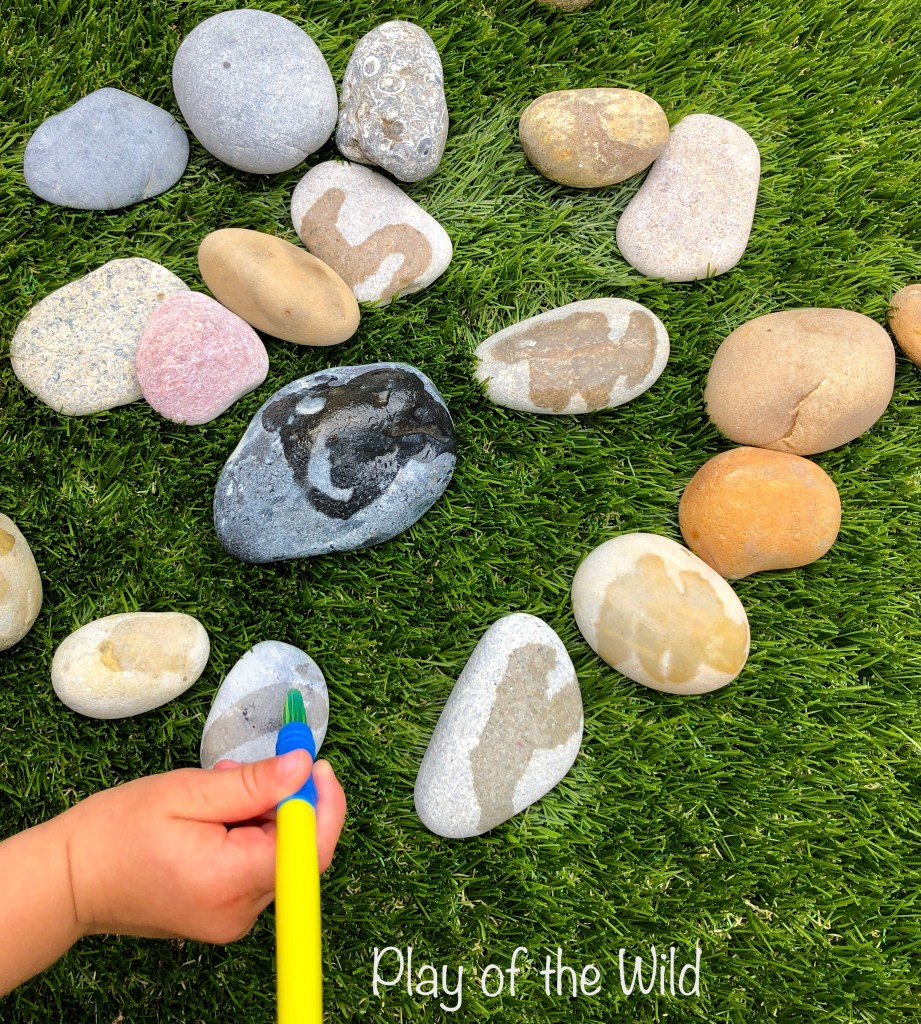 Mark making eyfs. Water and rocks.