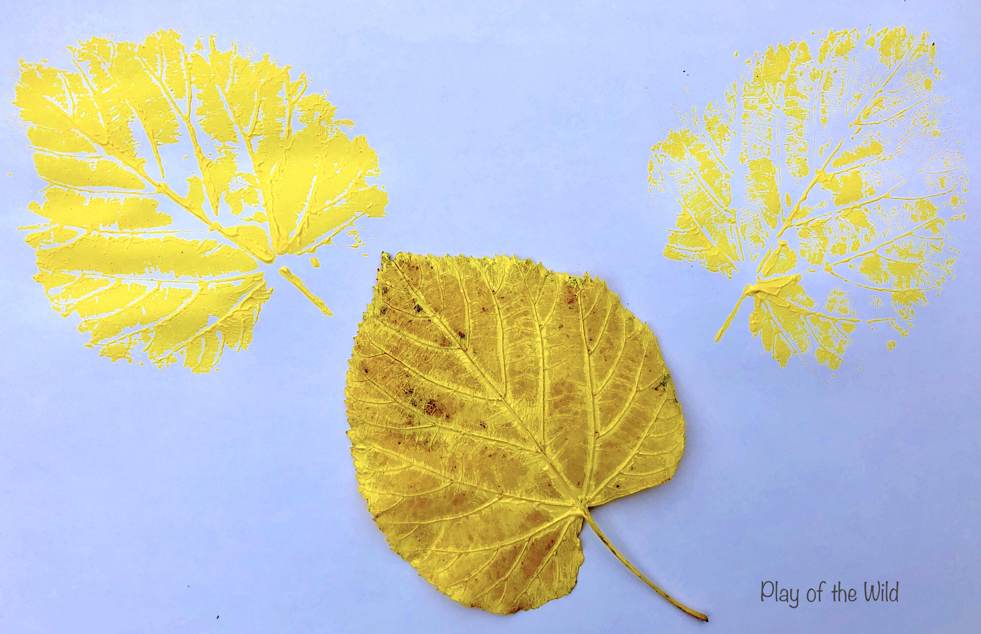 Making a leaf print painting.