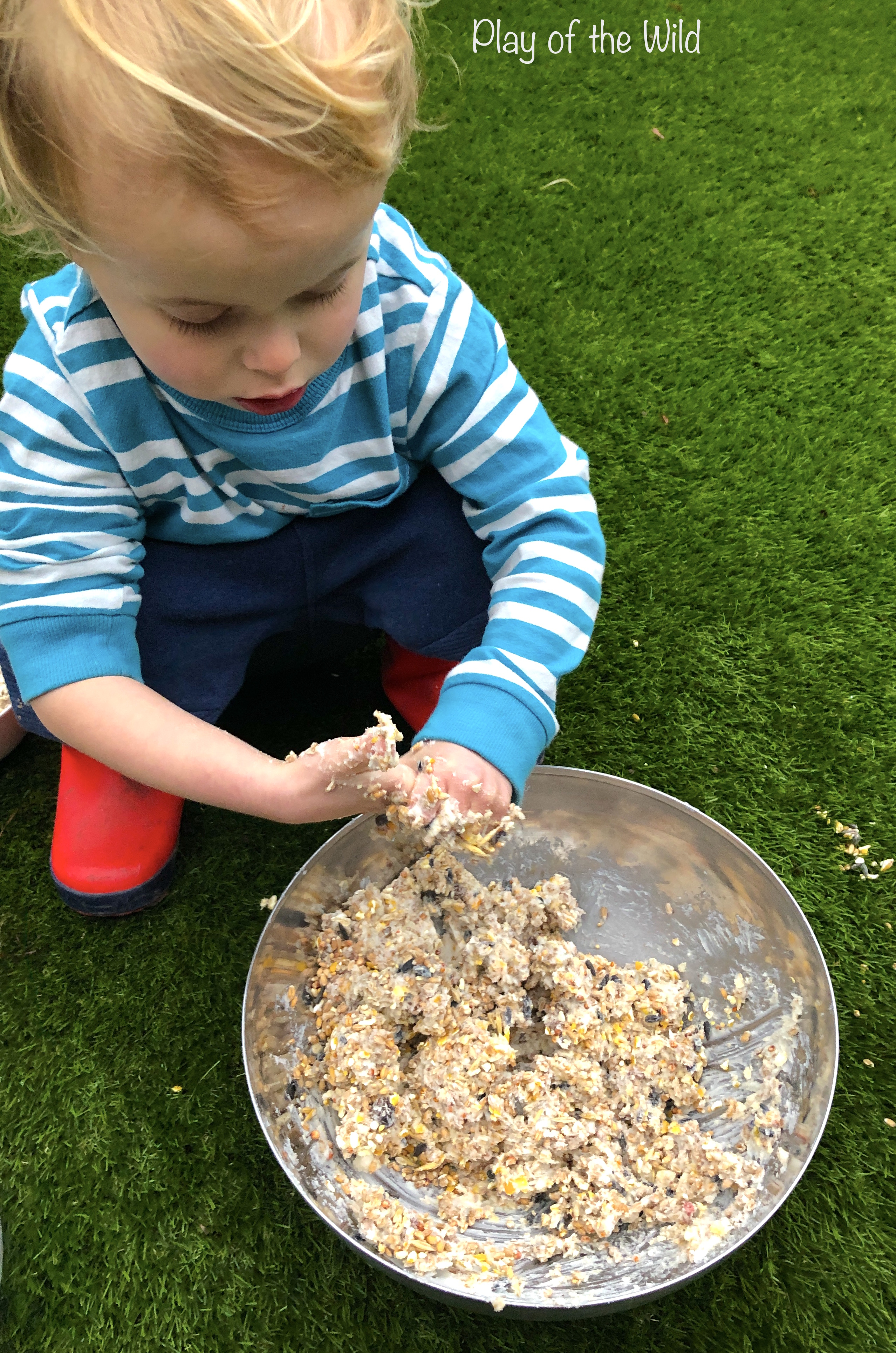 child mixing ingredients for bird