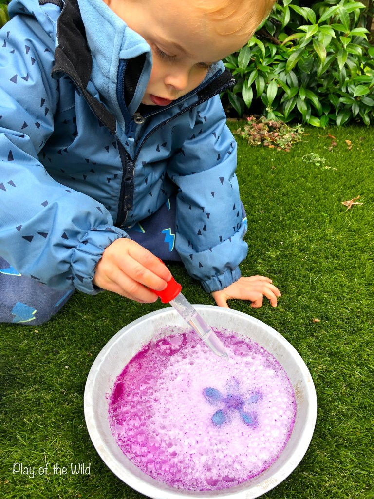 child experimenting with frozen baking soda and vinegar.