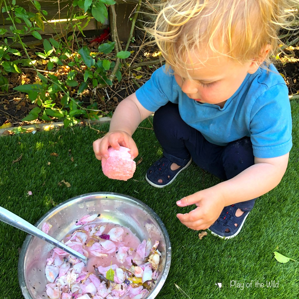making fizzy potions with petals, citric acid and baking soda.