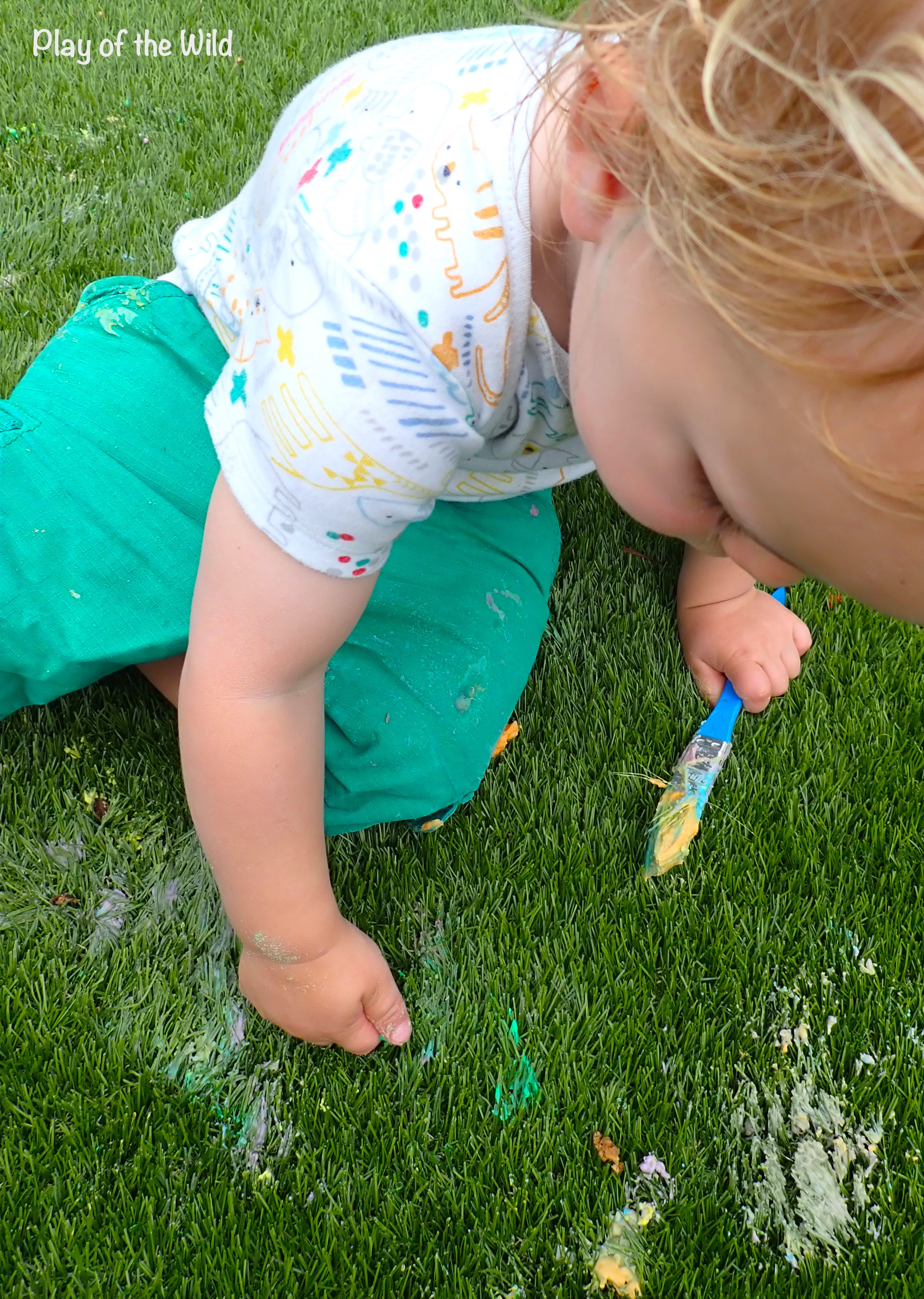 finger painting exploring sensory play