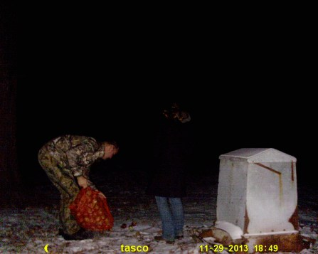 Matt and I replenishing the bait pile near the cabin with apples on Friday night.