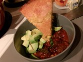 Dished up with avocado and cornbread, warm from the oven.