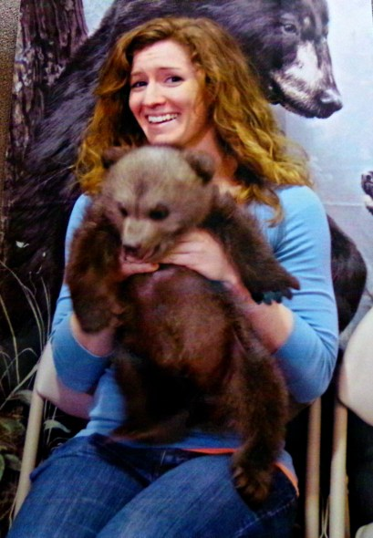 "And I held a baby grizzly bear. It tried to eat my hands, hence the look of ""Getitawayfromme"""