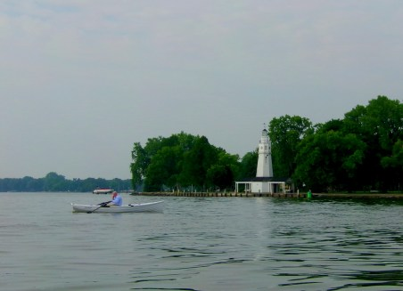 Just as we left the mouth of the inlet, we saw this man rowing his boat past the little lighthouse.