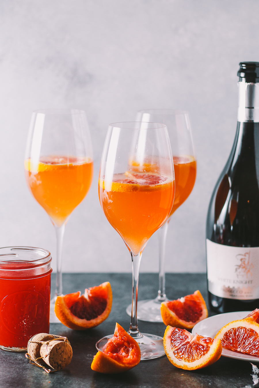 an update to a classic mimosa, these winter citrus mimosas are lightly sweetened with a homemade blood orange & honey syrup | mimosas | mimosa recipe | brunch cocktails | cocktails | cocktails recipe