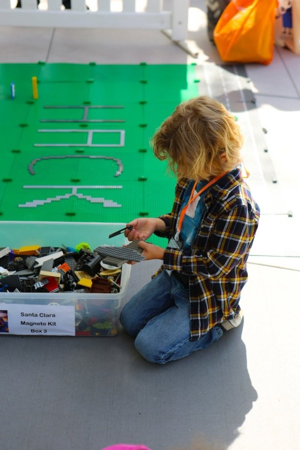 there-were-several-different-lego-stations-encouraging-kids-to-be-creative-kids-are-natural-hackers-goler-said