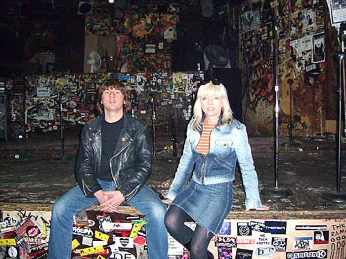 Andy and Debbie Harris on the CBGB stage after playing there. Photo courtesy of Andy Harris.