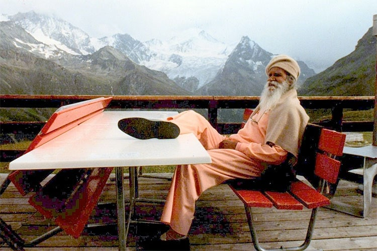 Swami Satchidananda on a rainy Swiss mountain By Rudraksha108 / Maithreyi Andre Marcela Andre [CC BY-SA 3.0 (https://creativecommons.org/licenses/by-sa/3.0) or GFDL