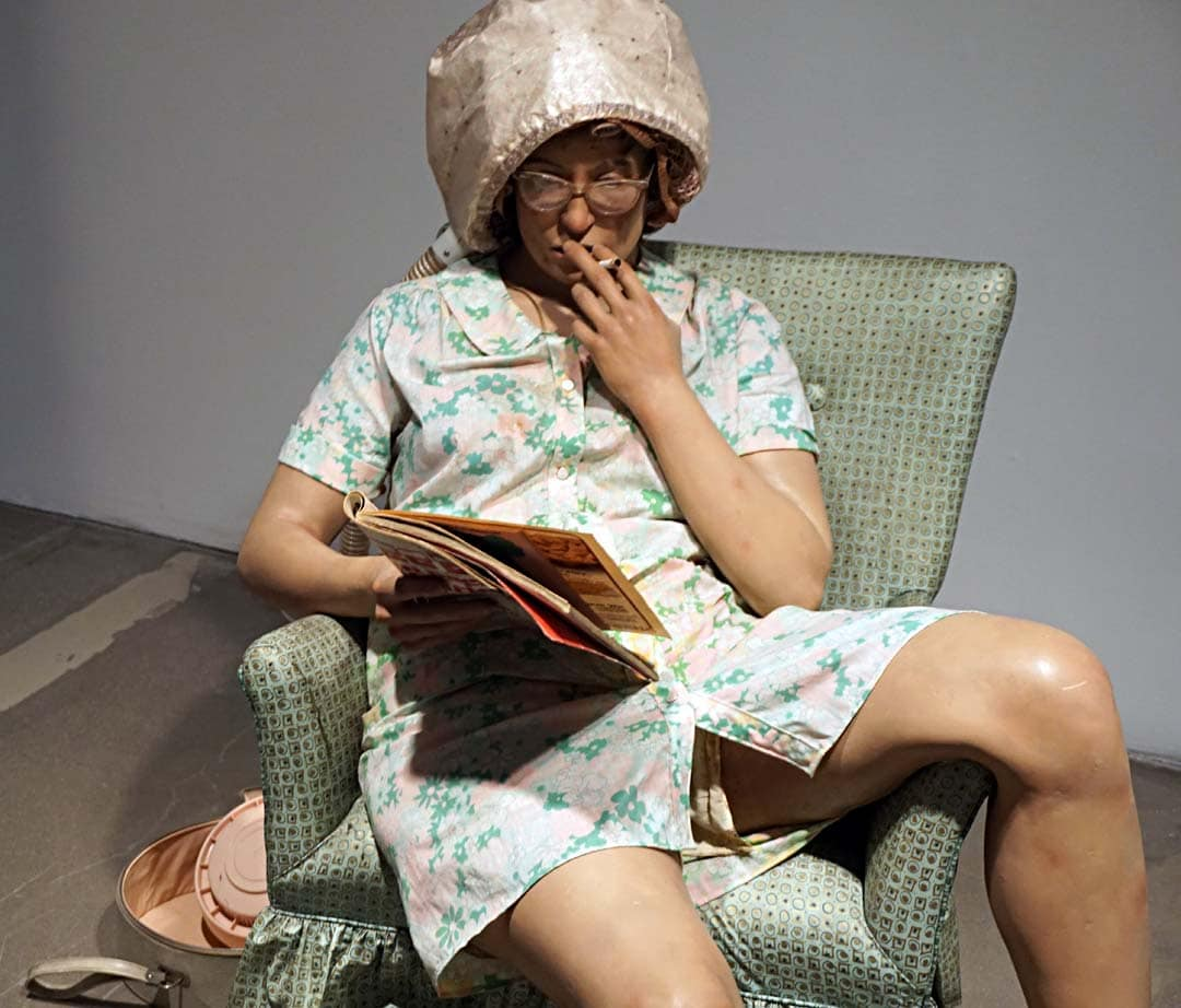 """Duane Hanson, American, 1925-1996 """"Housewife, 1969-1970: polyester, resin, and fiberglass, polychromed in oil and mixed media, with accessories"""" """"Hanson's typically lower and middle-class characters are empathetically portrayed in private or mundane moments; their appearance is at once startlingly present yet distinctly at odds in a gallery setting, where they are encountered almost voyeuristically, thus amplifying their isolation."""""""