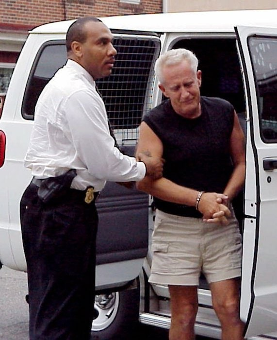 Corrections officer Mike Green, left, escorts convicted murderer Edward Solly from a van at Jersey State Prison in Trenton, N.J. Friday, May 18, 2001. Solly escaped in 1974 while on furlough from a New Jersey prison where he was serving time for murdering his girlfriend's 2-year-old son. Solly spent spent 27 years on the lam and posed as a doo-wop singer. (AP/N.J. Department of Corrections)