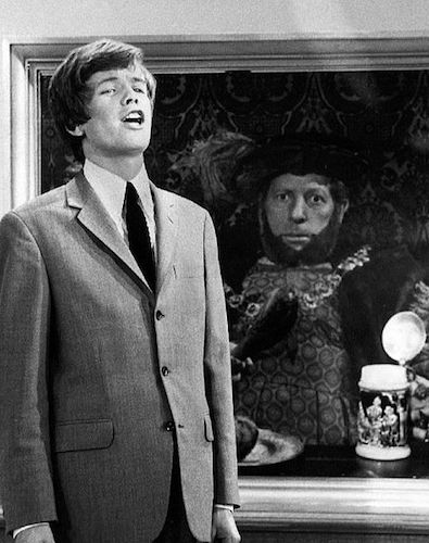 """Photo of Peter Noone and Danny Kaye from the television program The Danny Kaye Show. As Noone sings his hit """"Henry the VIII"""", the king's portrait behind him comes to life (Danny Kaye). By CBS Television"""