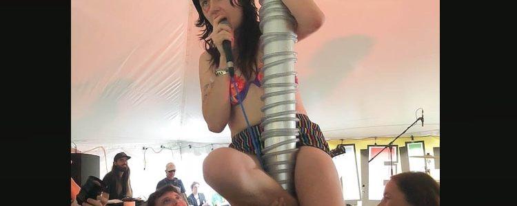 Dani of Surfbort climbing a pole during the set