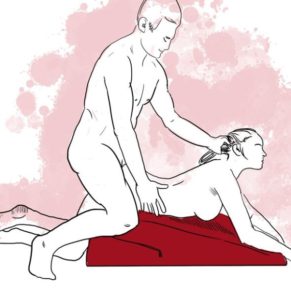 A sketch of a naked woman lying on her front on the Liberator Ramp sex position aid. A naked man is kneeling behind her and they are having sex.