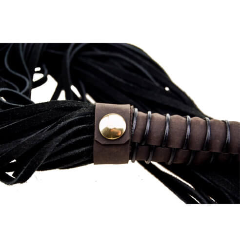 Close up on brass fixture of the Bound Nubuck Leather Flogger