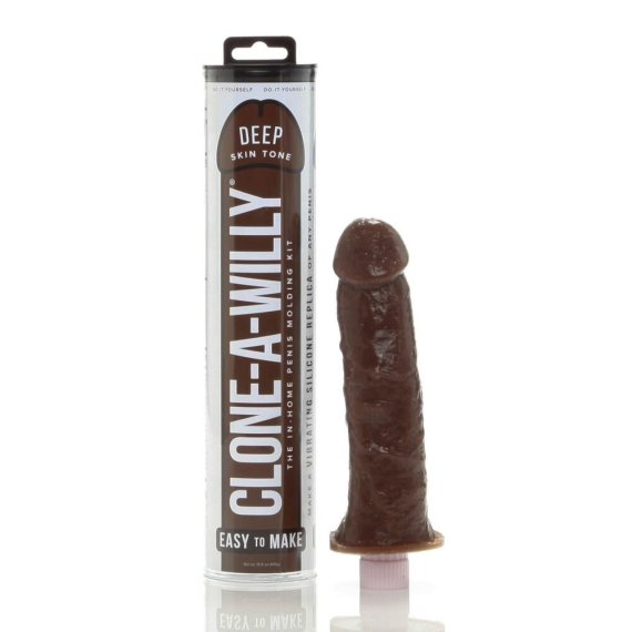 A dark flesh toned Clone-A-Willy Silicone molded dildo next to its cylindrical packaging