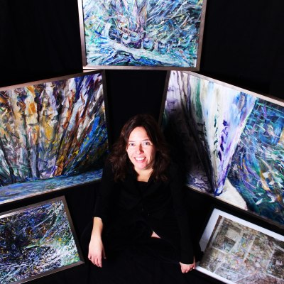 Kristy Simmons Poses with her Painting