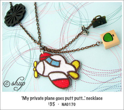 NA0170 - 'My private plane goes putt, putt...' necklace