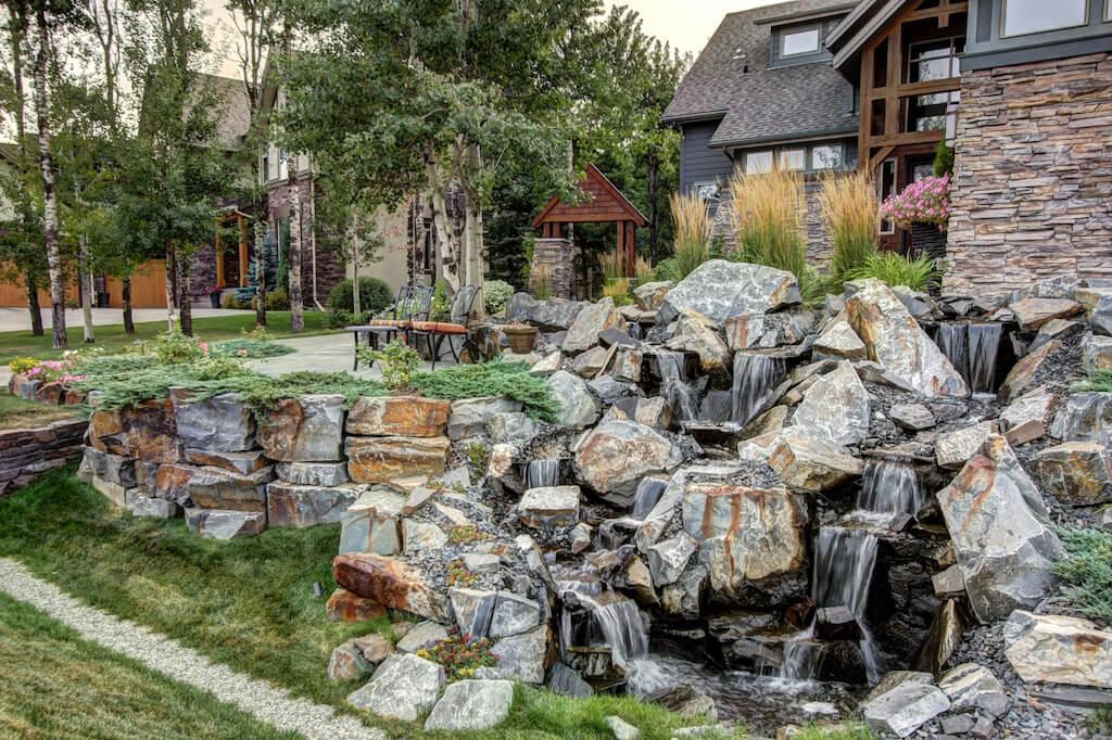 Rock-waterfall-landscaping-40-Wentwillow-lane-SW-west-springs-real-estate-for-sale-plintz-Realtor-calgary-sothebys-Luxury