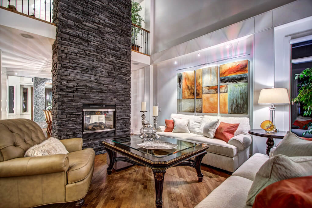 Stone-fireplace-great-room-40-Wentwillow-lane-SW-west-springs-real-estate-for-sale-plintz-Realtor-calgary-sothebys-Luxury