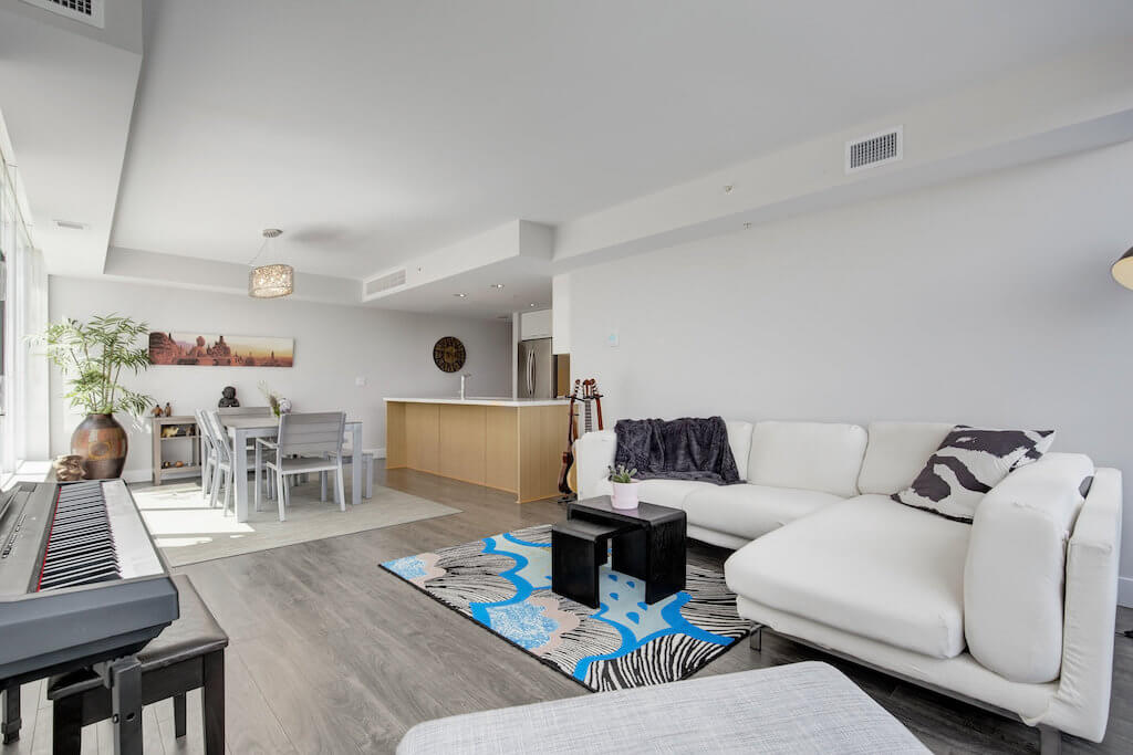 Open-living-room-evolution-Realtor-210-510-6-Avenue-SE-east-village-calgary-real-estate-for-sale-condo-plintz-sothebys