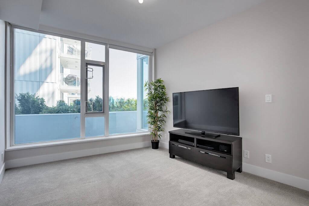 Den-bedroom-balcony-evolution-Realtor-210-510-6-Avenue-SE-east-village-calgary-real-estate-for-sale-condo-plintz-sothebys
