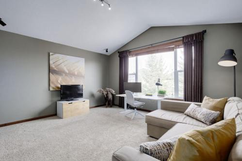 Family-room-upstairs-vaulted-ceilings-303-Valley-Crest-Court-NW-Valley-Ridge-Plintz-Real-Estate-For-Sale-Calgary-Alberta
