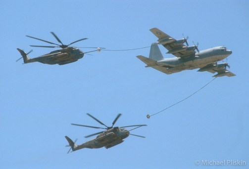 KC-130 Hercules refuels two MH-53 Super Stallions