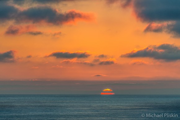 "The ""Green Flash"" appears momentarily at the top of the setting sun. The first and only time I have ever seen it."
