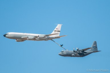 Air Force KC-135 Stratotanker refuels a C-130 Hercules