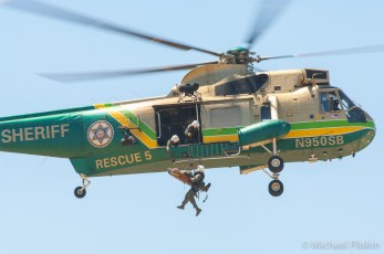 L.A. County Sheriff's Department Air Five Sikorsky SH-3H lifts rescuer and victim