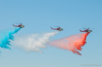 Los Angeles Fire Department helicopters in patriotic water drop display. (From left: Air 1 - Bell 412EF, Air 2 - Bell 412, Air 5 - Agusta SPA AW139)
