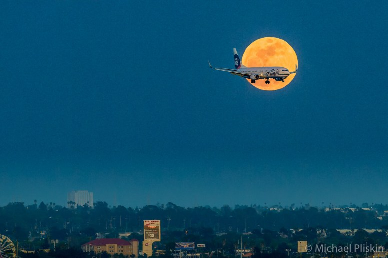 Alaska Airliner on approach to LAX passes in front of full moon.