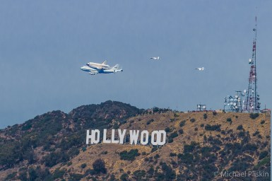 Space Shuttle Endeavour flies over the Hollywood sign on its final flight to Los Angeles retirement