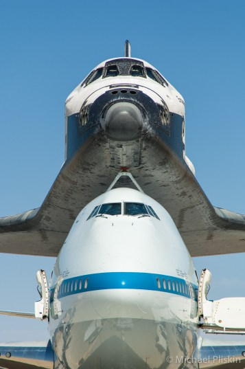 Space Shuttle Endeavour sits atop its Boeing 747 carrier at NASA Dryden facility at Edwards AFB