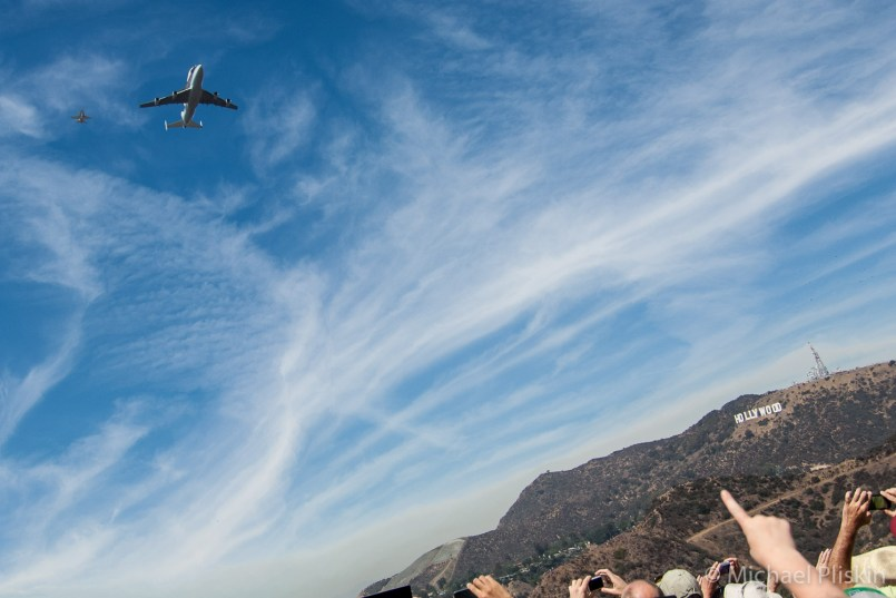 Spectators at the Griffith Park Observatory point to the Space Shuttle Endeavour as it makes its final flight over the Hollywood sign.