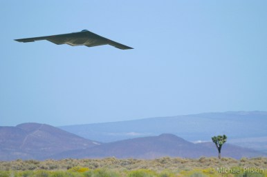 B-2 Spirit Stealth Bombr flies low over the Mojave Desert near Edwards Air Force Base, CA.