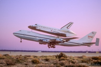 Space Shuttle Endeavour atop its Boeing 747 carrier takes off at sunrise from Air Force Plant 42 in Palmdale, CA to fly to Kennedy Space Center for its first space flight.