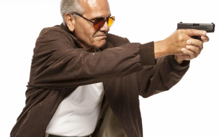 Older man aiming his gun