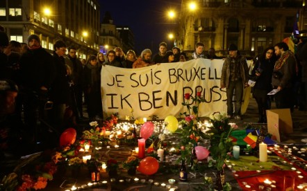 People gather with tributes to Belgium terror victims