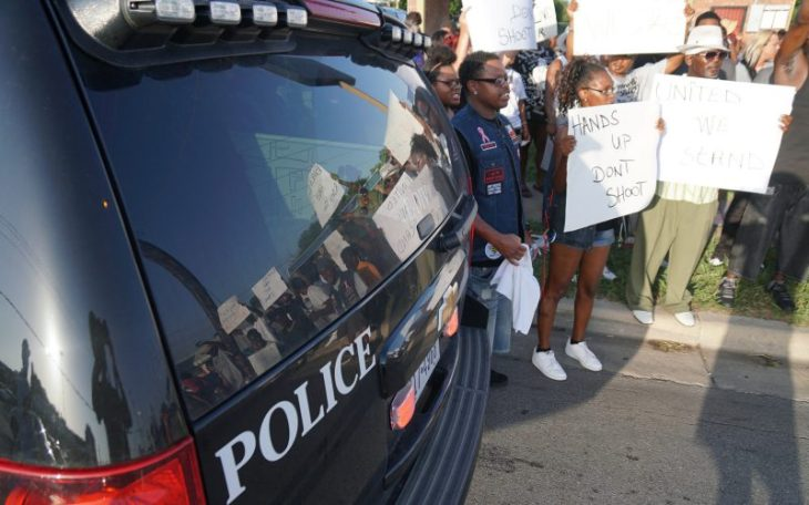 More than a hundred people participated in a protest to stop the killing of black men on Miller Street on Sunday, July 10, 2016 in Fort Worth, Texas. The police department worked with the protestors to control traffic during the march. (Lawrence Jenkins/Fort Worth Star-Telegram/TNS)