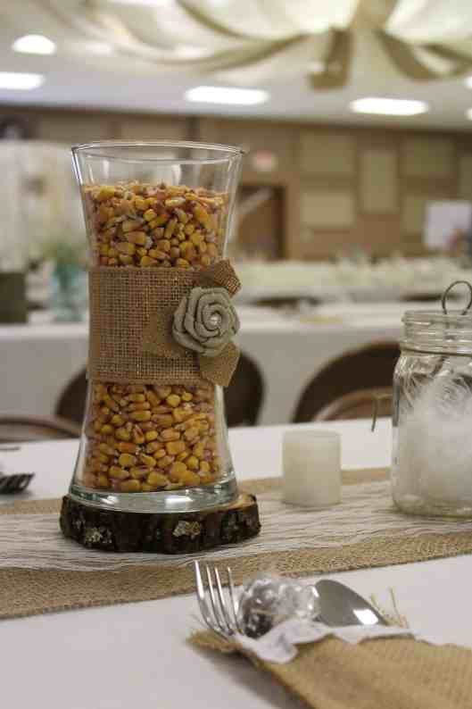 corn filled vase with burlap ribbon