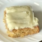 "square piece of ""the best cake recipe"" with homemade cream cheese icing"