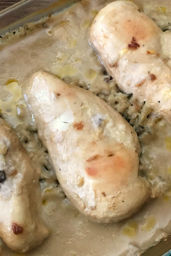 Chicken breast baked in oven with rice and gravy without peeking