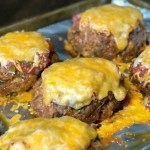 Individual taco meatloaf covered in cheddar cheese