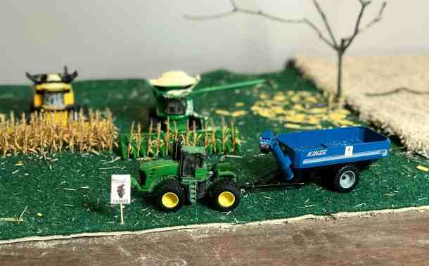 Two combines in harvest farm toy scene