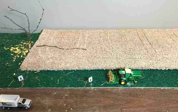 farm toy soybean field with tire tracks