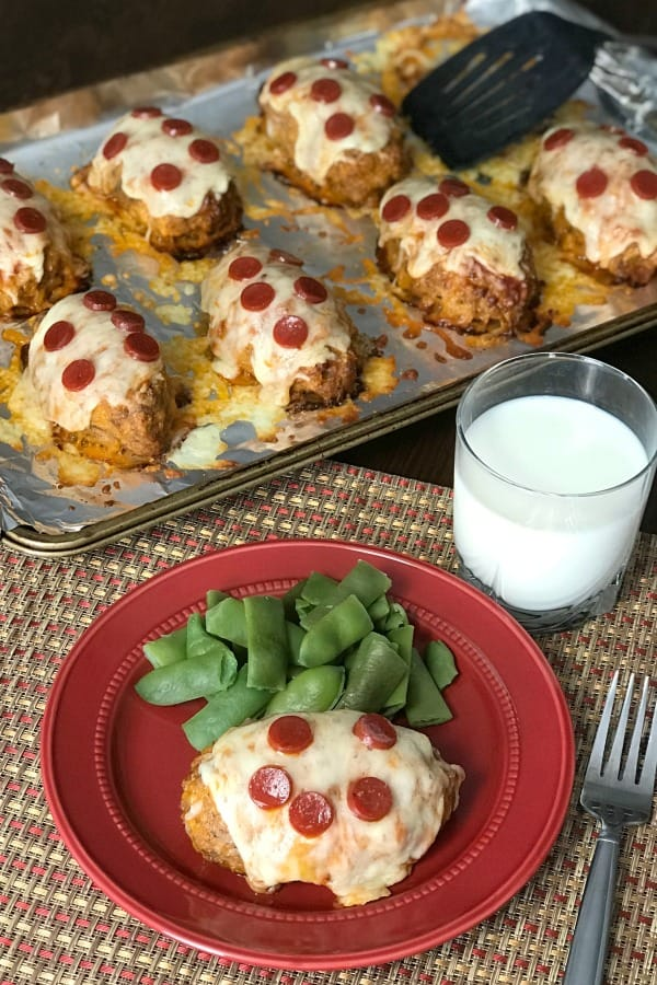 We love pizza and meatloaf, so we've been working to perfect the Best Pizza Meatloaf!  Everyone in our family loves this meal because the meat is so tender, the sauce keeps the meatloaves moist and the cheese and pepperoni add great flavor!  #pizzaparty #meatloaf